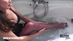 Hot Milf tease covers sexy feet in soaking wet stockings Thumb