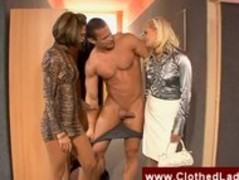 Clothed secretaries blowing a naked guy Thumb