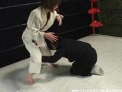 Mistress beats up gagged slave in wrestling match inside the ring Thumb