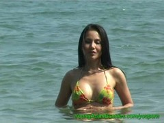 busty asian on the beach Thumb