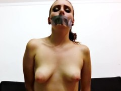 Topless Young Girl with Puffy Nipples Taped at Mouth and Bound Thumb