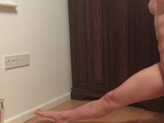 Shredded gymnast stretches her muscles Thumb