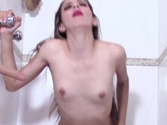Tight Skinny Babe Bangs Two Wall Mounted Dildos in the Shower Thumb