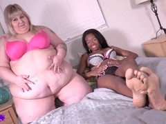 fat white girl and skinny black girl compare bellies Thumb