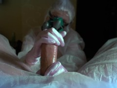 woman in a gas mask and gloves jerks off a cock and sucks. Handjob, blowjob Thumb