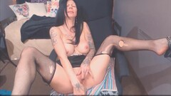 Tattooed MILF in sexy ripped stockings Thumb
